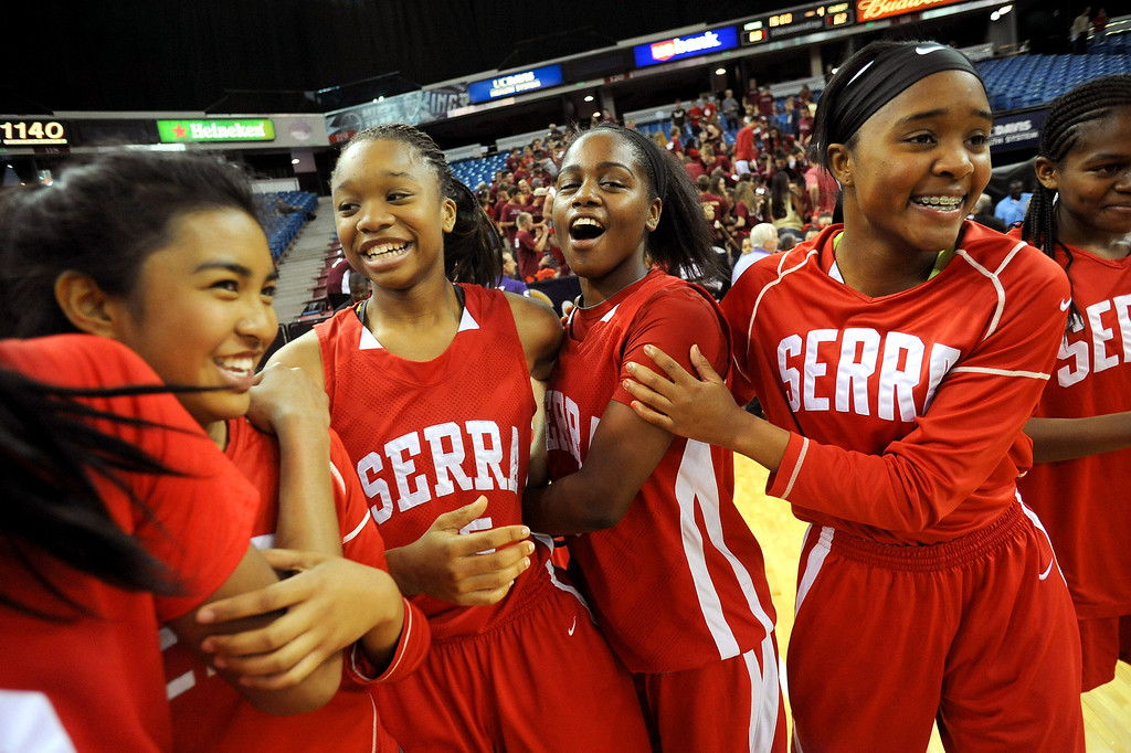 . Serra High School players celebrate following their 62-60 win over Salesian High School during the Division IV 2013 CIF State Basketball Championship at the Sleep Train Arena, in Sacramento, Ca March 23, 2013.(Andy Holzman/Los Angeles Daily News)