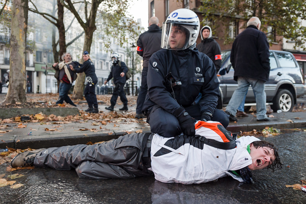 . A protestor screams as he is arrested, during a national trade union demonstration in Brussels, Thursday Nov. 6, 2014.  (AP Photo/Geert Vanden Wijngaert)