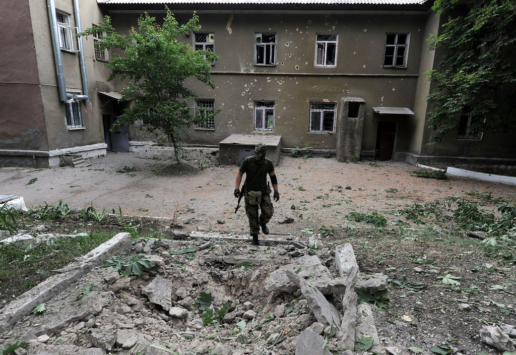 . A pro-Russian militant believed to have sustained wounds during combats between separatists and Ukrainian troops, walks in front of the hospital in Semyonovka village, not far from the eastern Ukrainian city of Slavyansk, on May 25, 2014. A bitterly divided Ukraine voted Sunday in a presidential election seen as crucial to ending months of upheaval and bloodshed that has sent the country to the brink of civil war.   VIKTOR DRACHEV/AFP/Getty Images