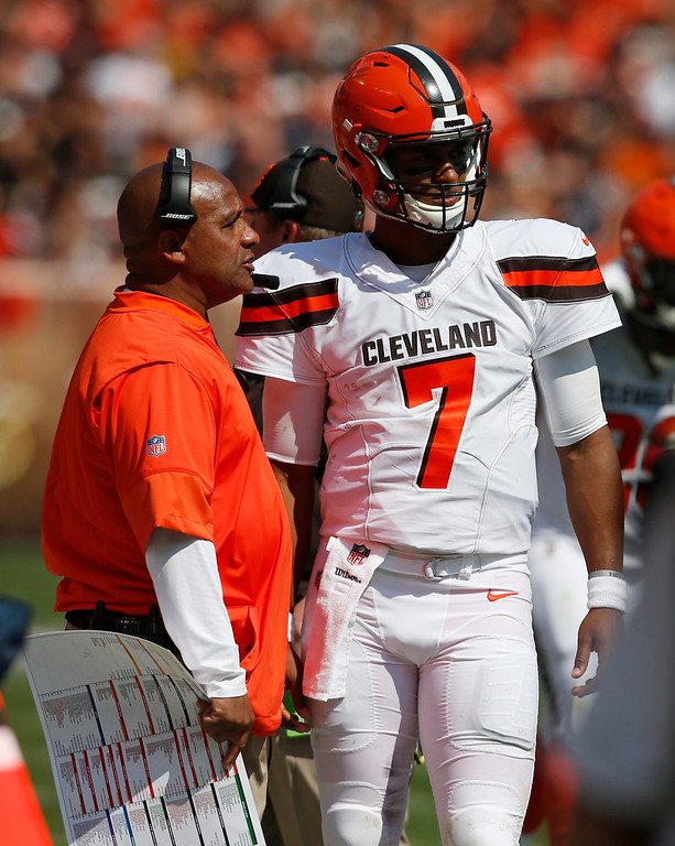 . Cleveland Browns head coach Hue Jackson, left, talks with quarterback DeShone Kizer (7) during the first half of an NFL football game against the Pittsburgh Steelers, Sunday, Sept. 10, 2017, in Cleveland. (AP Photo/Ron Schwane)