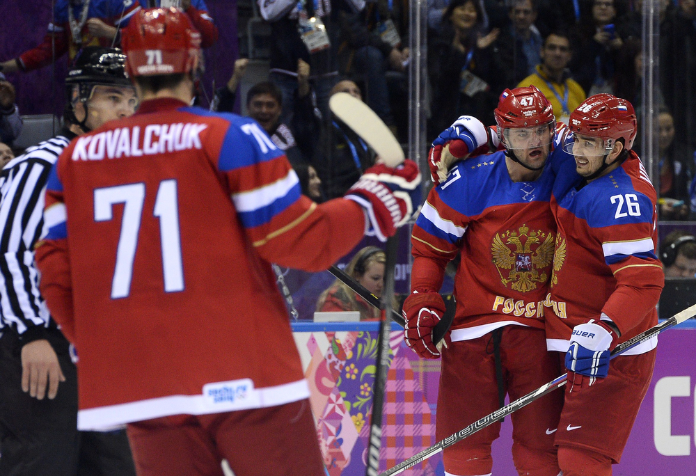 . Russia\'s Alexander Radulov (C) celebrates with teammates after scoring during the Men\'s Ice Hockey play-offs qualification match Russia vs Norway at the Bolshoy Ice Dome during the Sochi Winter Olympics on February 18, 2014.  (JONATHAN NACKSTRAND/AFP/Getty Images)