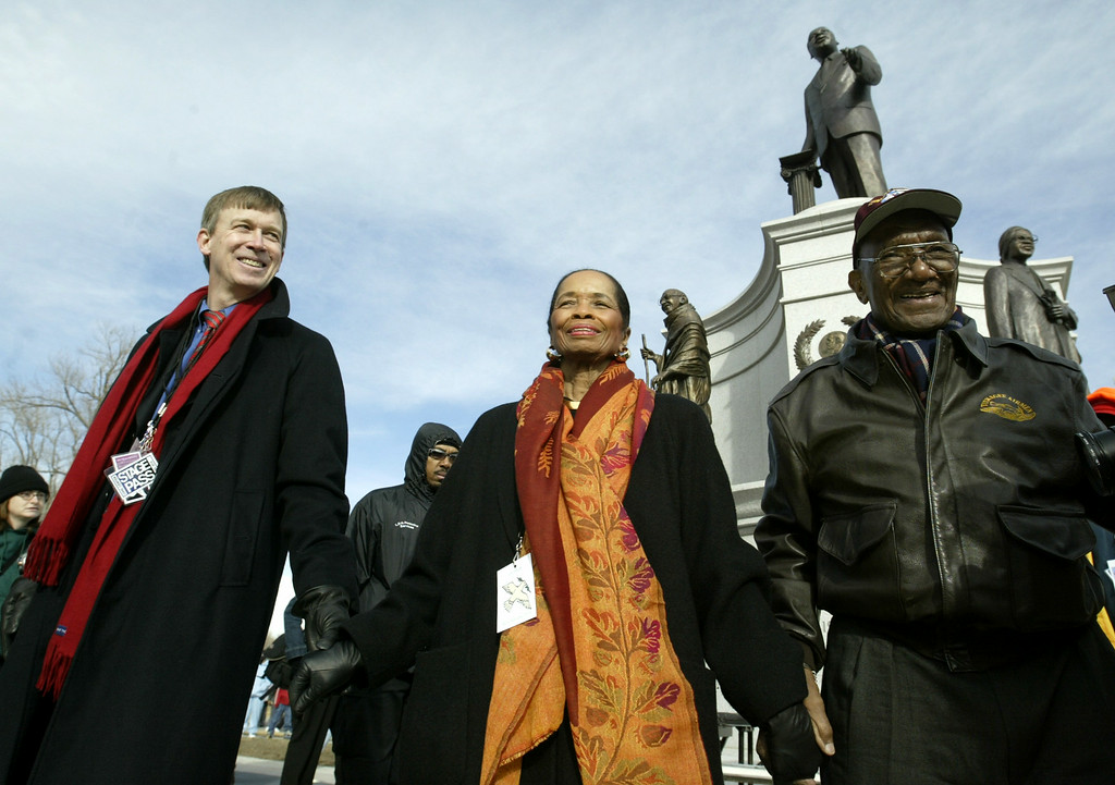 . Denver Mayor John Hickenlooper, left, walks away from the Martin Luther King Jr. memorial after placing a wreath on the memorial with 2004 MLK Parade grand marshals Edna and John Mosley at City Park in Denver, Monday, Jan. 19, 2004. (AP Photo/Jack Dempsey)