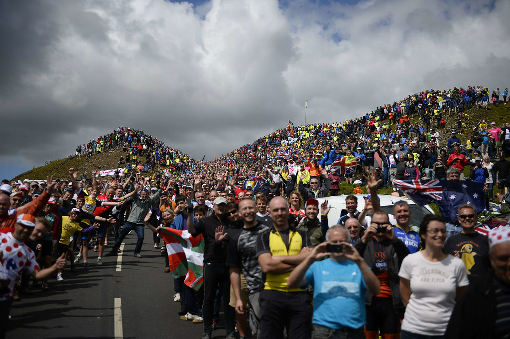. Supporters are pictured along the road during the 190.5 km first stage of the 101st edition of the Tour de France cycling race on July 5, 2014 between Leeds and Harrogate, northern England. The 2014 Tour de France gets underway on July 5 in the streets of Leeds and ends on July 27 down the Champs-Elysees in Paris. ERIC FEFERBERG/AFP/Getty Images