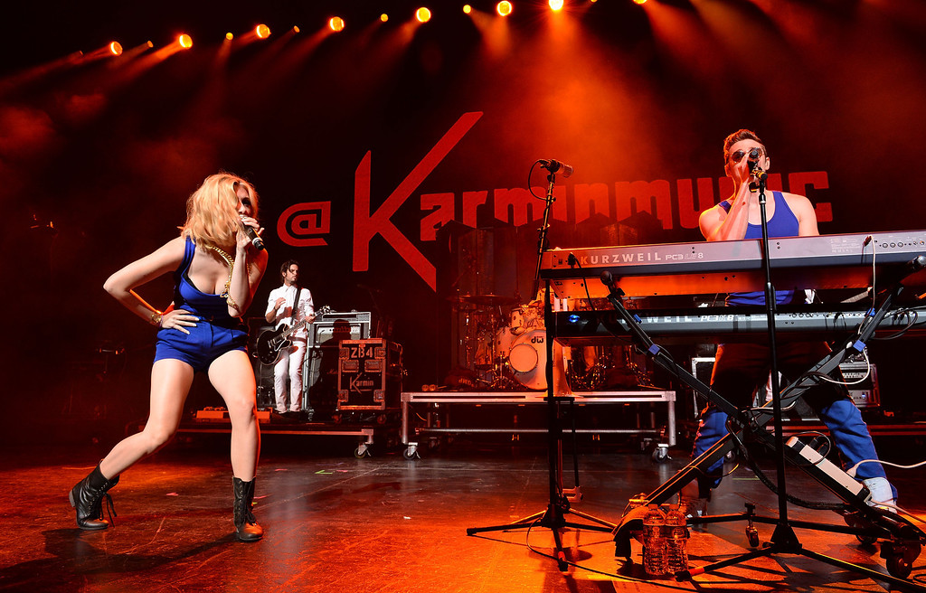 . UNIVERSAL CITY, CA - AUGUST 16:  Singer Amy Heidemann (L) and Nick Noonan of the musical group \'Karmin\' perform at the Gibson Amphitheatre on August 16, 2013 in Universal City, California.  (Photo by Mark Davis/Getty Images)
