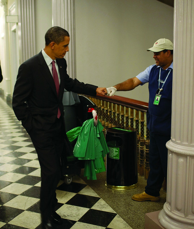 . President Barack Obama fist-bumps AbilityOne custodian, Lawrence Lipscomb, in a federal office building following the opening session of the White House Forum on Jobs and Economic Growth. Credit: Official White House Photo by Pete Souza.  (PRNewsFoto/AbilityOne, Pete Souza)