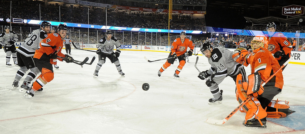. All eyes on the puck in the third period of the inaugural NHL Stadium Series game between the Anaheim Ducks and the Los Angeles Kings at Dodger Stadium in Los Angeles on Saturday, Jan. 25, 2014. Anaheim Ducks won 3-0. (Keith Birmingham Pasadena Star-News)