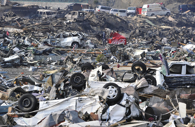 . In this photo taken Sunday, March 13, 2011, debris covers Otsuchicho town, northern Japan, two days after a powerful earthquake-triggered tsunami hit the country\'s east coast. (AP Photo/The Yumiuri Shimbun, Yasuhiro Takami)