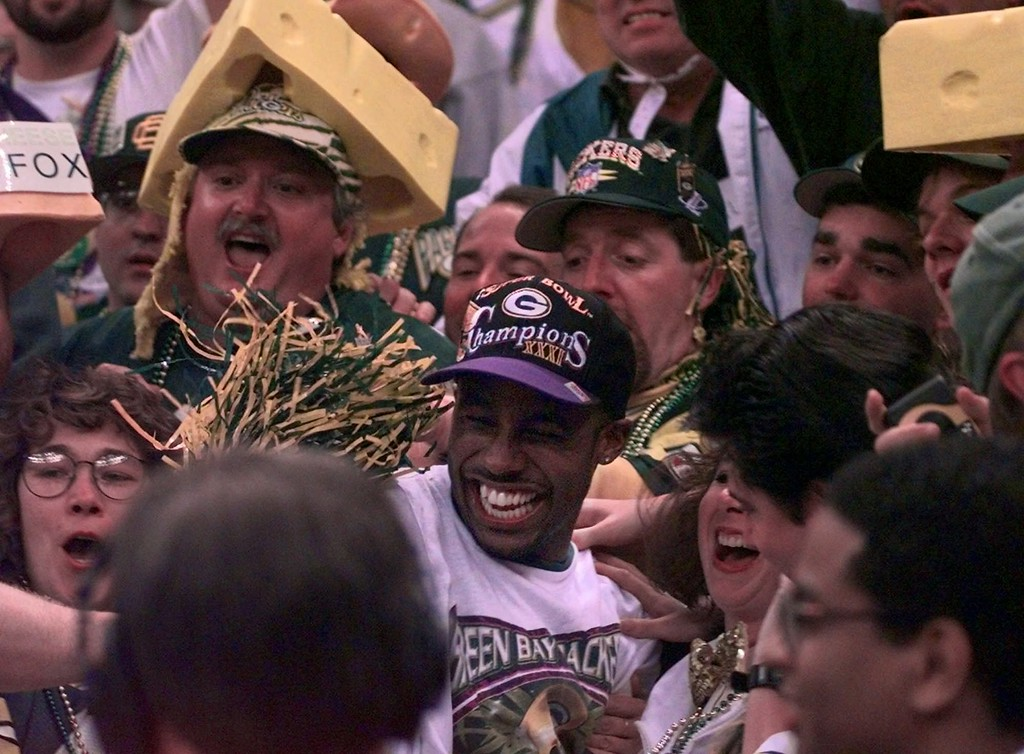 . Green Bay Packers\' Desmond Howard, center foreground, celebrates with Packers fans after his team defeated the New England Patriots 35-21 to win Super Bowl XXXI in New Orleans Sunday Jan. 26, 1997. Howard was named MVP. (AP Photo/Elise Amendola)