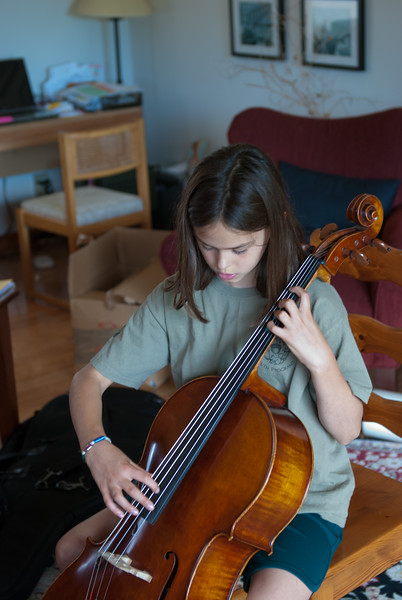 r practicing her cello