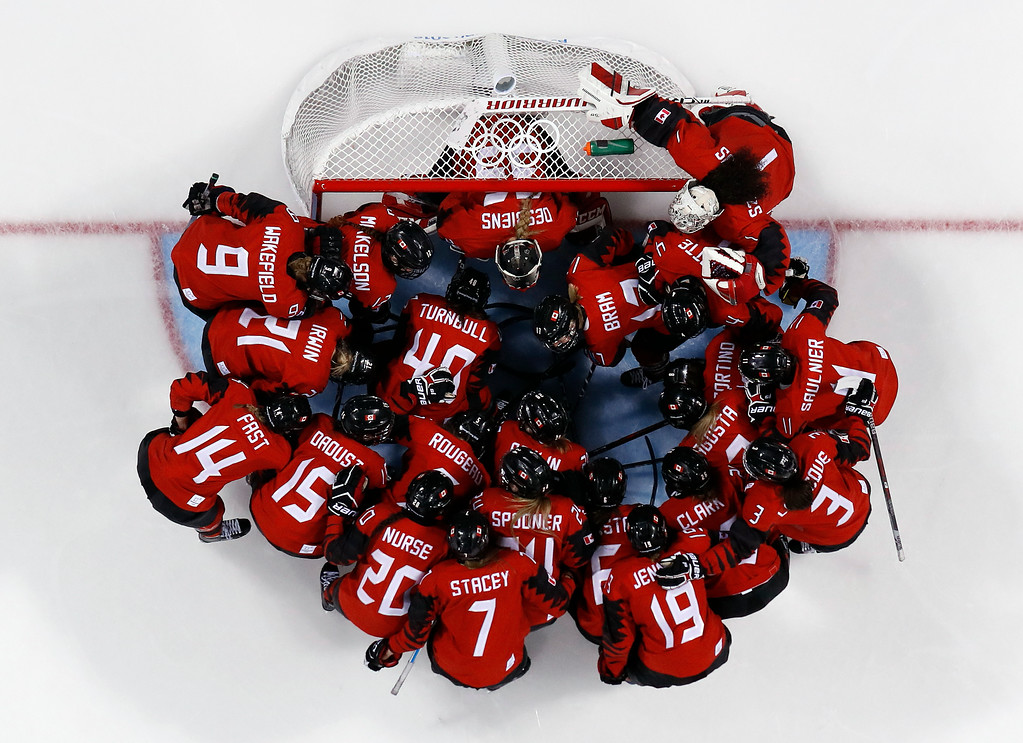 . Players from Canada gather around the goal before the preliminary round of the women\'s hockey game against the team from Russia at the 2018 Winter Olympics in Gangneung, South Korea, Sunday, Feb. 11, 2018. (AP Photo/Frank Franklin II)
