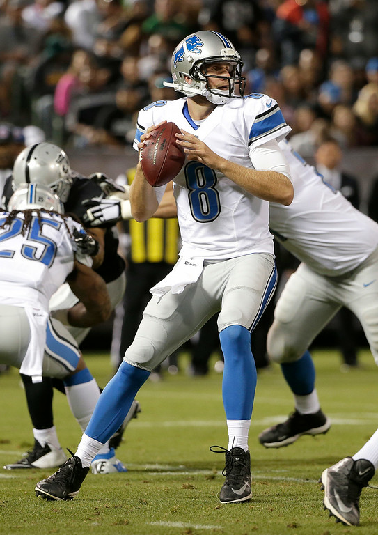 . Detroit Lions quarterback Dan Orlovsky (8) passes against the Oakland Raiders during the second quarter of an NFL preseason football game in Oakland, Calif., Friday, Aug. 15, 2014. (AP Photo/Marcio Jose Sanchez)