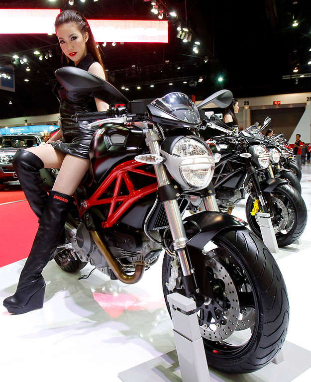 . A model poses on a Ducati Monster 795 ABS during a media presentation of the 34th Bangkok International Motor Show in Bangkok March 26, 2013. The Bangkok International Motor Show will be held from March 27 to April 7. REUTERS/Chaiwat Subprasom