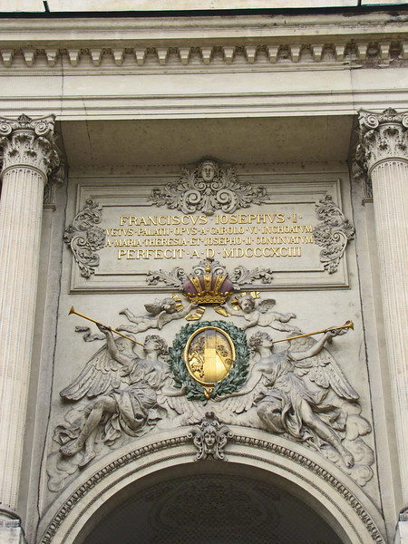 10-Detail in arch above entry from Michaeler Platz. Date of inscription is 1893.