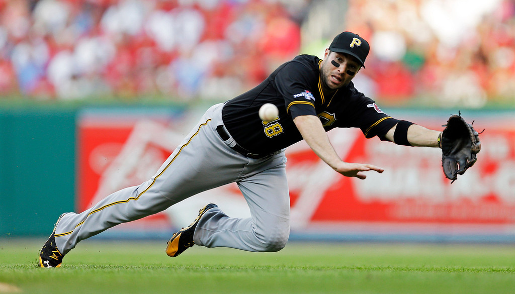 . Pittsburgh Pirates second baseman Neil Walker dives for a single hit by St. Louis Cardinals\' Matt Adams in the fourth inning of Game 1 of baseball\'s National League division series on Thursday, Oct. 3, 2013, in St. Louis. (AP Photo/Jeff Roberson)