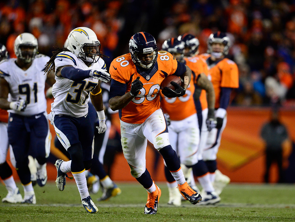 . DENVER, CO - JANUARY 12: Denver Broncos tight end Julius Thomas (80) catches a 17-yard pass in the fourth quarter. The Denver Broncos take on the San Diego Chargers at Sports Authority Field at Mile High in Denver on January 12, 2014. (Photo by AAron Ontiveroz/The Denver Post)