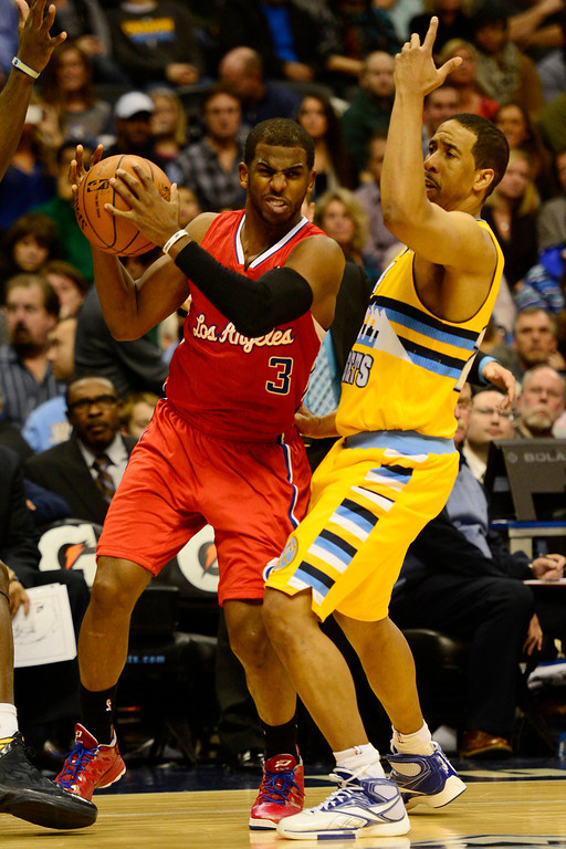 . Denver Nuggets point guard Andre Miller (24) pressures Los Angeles Clippers point guard Chris Paul (3) during the second half of the Nugget\'s 92-78 win at the Pepsi Center on Tuesday, January 1, 2013. AAron Ontiveroz, The Denver Post