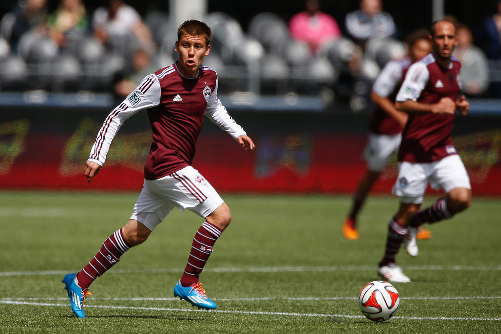 . Dillon Serna #17 of the Colorado Rapids dribbles against the Seattle Sounders FC at CenturyLink Field on April 26, 2014 in Seattle, Washington. The Sounders defeated the Rapids 4-1. (Photo by Otto Greule Jr/Getty Images)