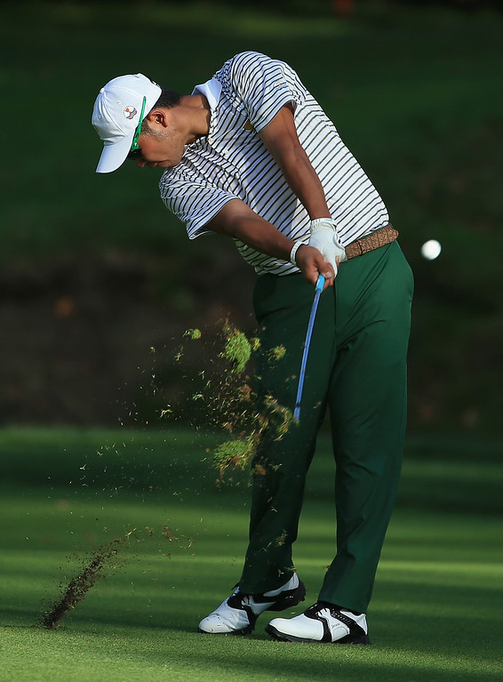 . DUBLIN, OH - OCTOBER 03:  Hideki Matsuyama of Japan and the International Team hits his third shot on the 15th hole during the Day One Four-Ball Matches at the Muirfield Village Golf Club on October 3, 2013  in Dublin, Ohio.  (Photo by David Cannon/Getty Images)
