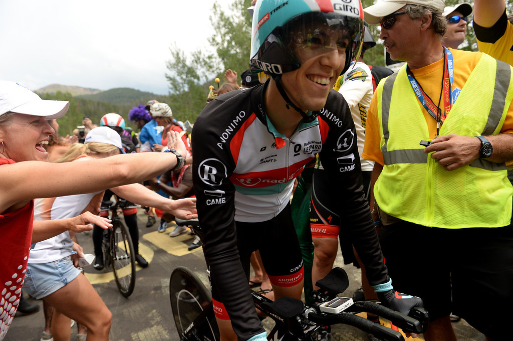 . Fans celebrate seeing Tony Gallopin of Radio Shack after his climbing Vail pass the 10-mile Individual Time Trial of 2013 USA Pro Challenge, August 23, 2013. (Photo by Hyoung Chang/The Denver Post)