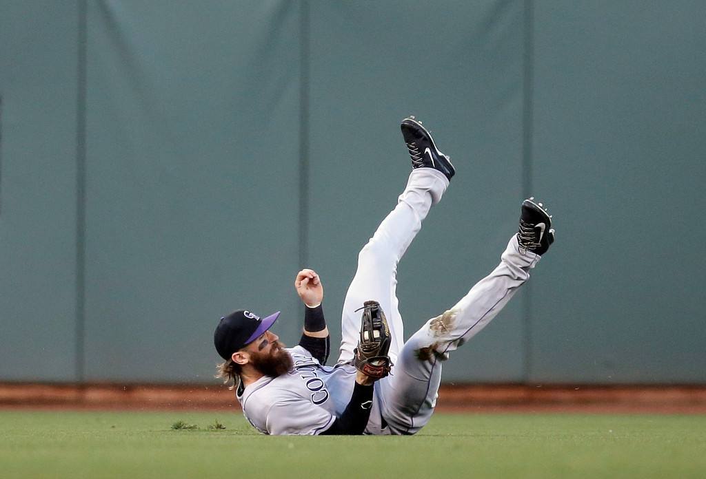. Colorado Rockies center fielder Charlie Blackmon tumbles as he makes a catch on a pop fly from San Francisco Giants\' Brandon Belt during the first inning of a baseball game Thursday, May 5, 2016, in San Francisco. (AP Photo/Marcio Jose Sanchez)