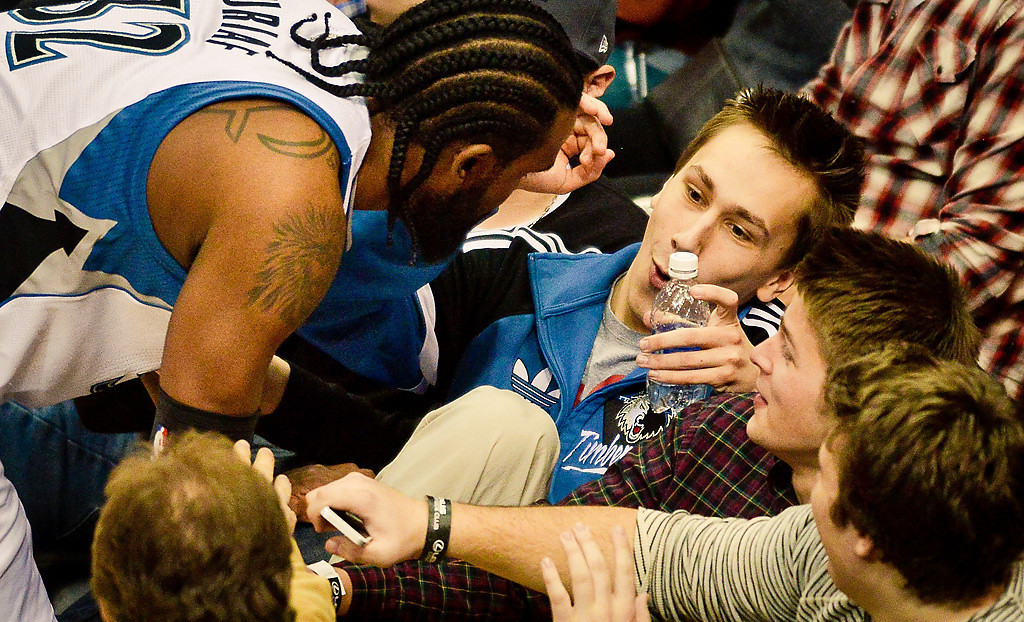 . Minnesota Timberwolves center Ronny Turiaf nearly knocks over a couple fans after going for a loose ball in the second quarter. (Pioneer Press: Ben Garvin)