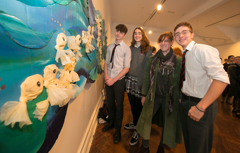 "15/01/2019. FREE TO USE IMAGE. Pictured at Garter Lane Arts Centre, Waterford city at an art exhibition ""the good, the bad and the ugly"" that discusses plastics. Recycle, reuse, reduce, replace – WIT and Waterford schoolgirls to exhibit exceptional art installation with thought-provoking components made from household plastics, pictured are Cillian O'Sullivan, Lucia Liria and Rafa Perez from Waterpark school with artist Rachel Smith. Picture: Patrick Browne"