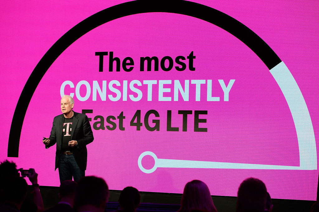 . Neville Ray, CTO of T-Mobile US, Inc. announces that T-Mobile\'s nationwide 4G LTE network is the fastest in the country, according to millions of real-time speed tests involving more than 1 million consumers, at T-Mobile\'s Un-carrier 4.0 press event at International CES on Wednesday, Jan. 8, 2014 in Las Vegas. (Jeff Bottari / AP Images for T-Mobile)