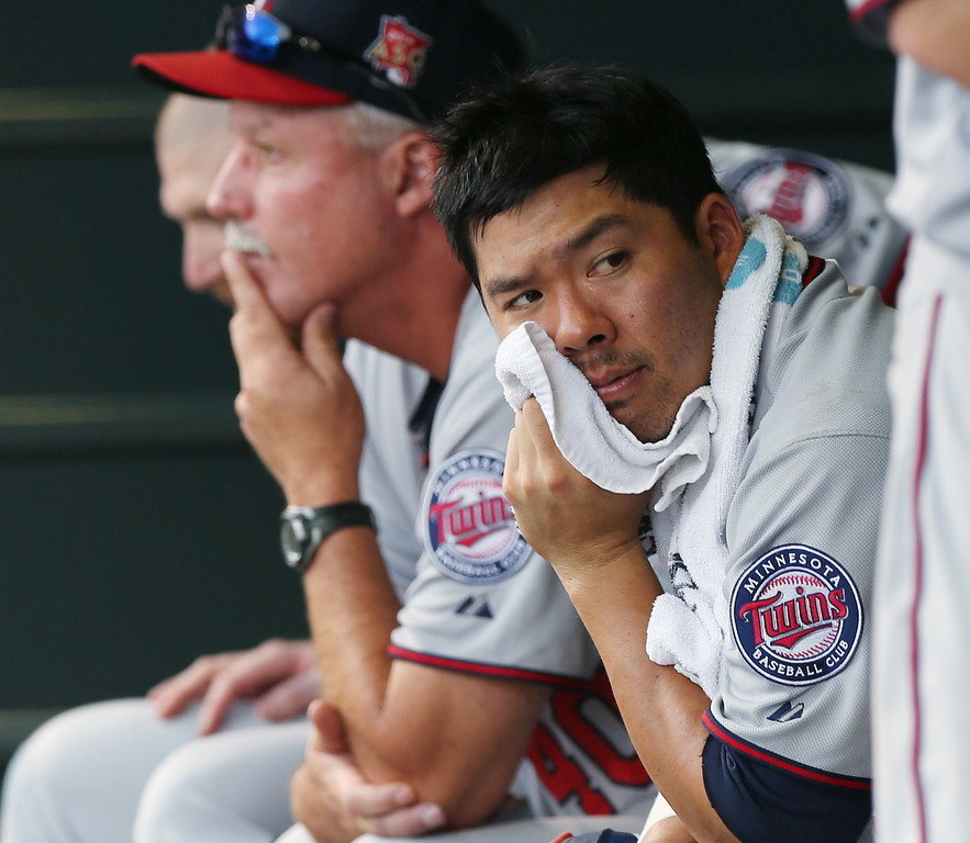 . Minnesota Twins catcher Kurt Suzuki looks on from dugout against the Colorado Rockies in the eighth inning. (AP Photo/David Zalubowski)