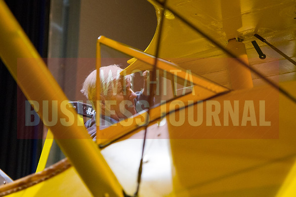 Stearman trainer on stage at Wichita State