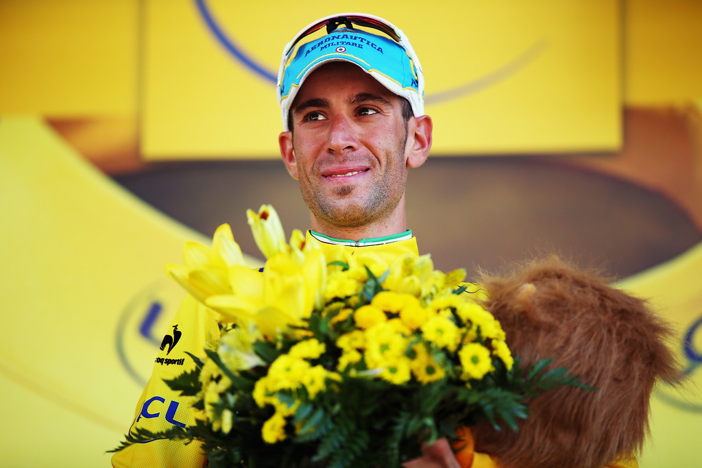 . Vincenzo Nibali of Italy and the Tinkoff-Saxo team celebrates retaining his race leader\'s yellow jersey stage 16 of the 2014 Tour de France, a 238km stage between Carcassonne and Bagneres-de-Luchon, on July 22, 2014 in  Bagneres-de-Luchon, France.  (Photo by Bryn Lennon/Getty Images)