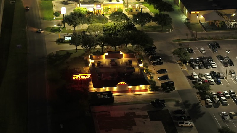 Night aerial video Outback Steakhouse restaurant