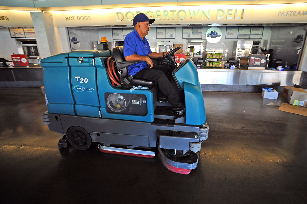 . Floors are cleaned in preparation for the the Opening Weekend series with the Giants at Dodger Stadium Thursday April 3, 2014.(Andy Holzman/Los Angeles Daily News)