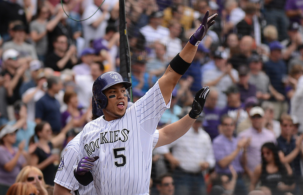 . Carlos Gonzalez (5) of the Colorado Rockies celebrates after scoring on a double by Troy Tulowitzki (2) of the Colorado Rockies in the third inning.(Photo by Hyoung Chang/The Denver Post)