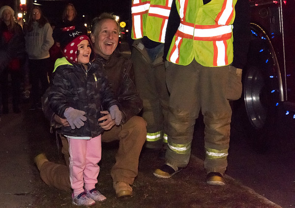 12/06/18 Wesley Bunnell | Staff Plainville held a tree lighting ceremony on Thursday at Fire HQ featuring singing, refreshments and a visit from Santa with a chance to sit on his lap. Barry Thomasen and his granddaughter Eliana, age 3, watch as Santa arrives on a fire truck.