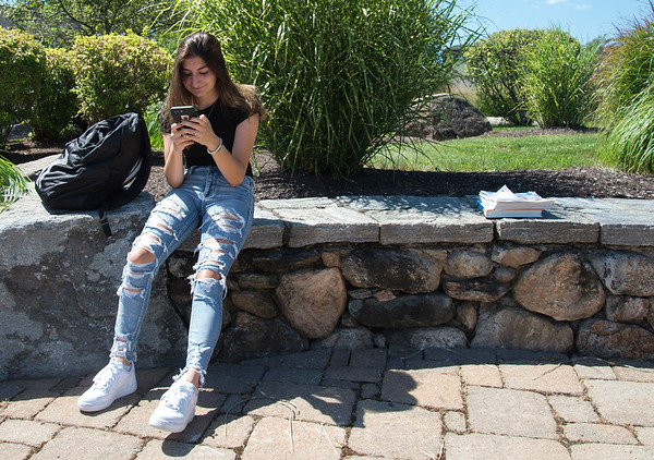 08/29/19 Wesley Bunnell | Staff Jessica Buttafuoco of Cromwell, a freshman at CCSU, enjoys some down time in the sun on the school's campus on August 29, 2019.