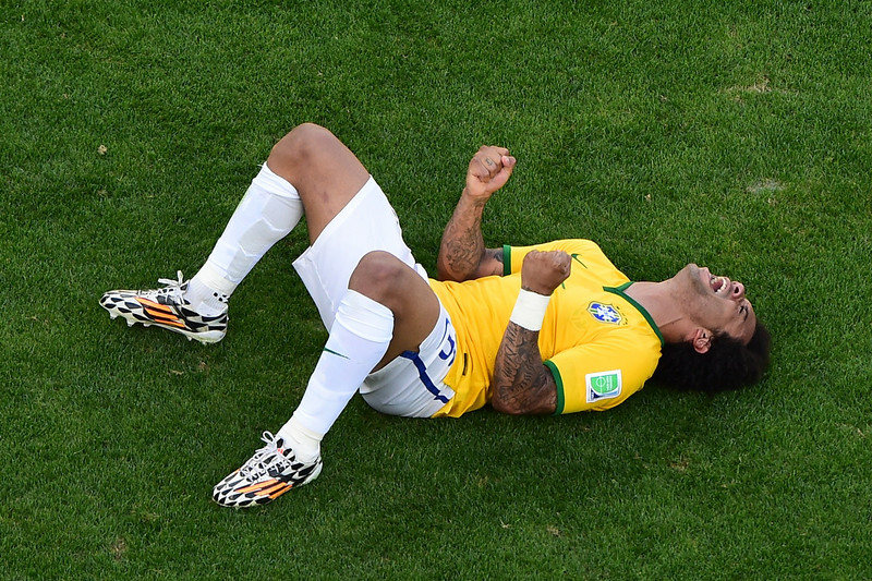 . Brazil\'s defender Marcelo celebrates at the end of the penalty shootout after the extra time in the round of 16 football match between Brazil and Chile at The Mineirao Stadium in Belo Horizonte during the 2014 FIFA World Cup on June 28, 2014. (FRANCOIS XAVIER MARIT/AFP/Getty Images)
