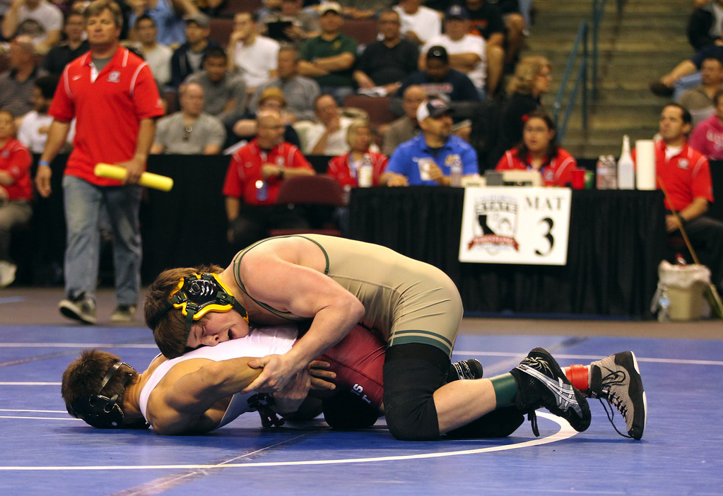 . Paradise\'s Wyatt Wyckoff, top, wrestles Clovis West\'s Michalel Knoblauch in a 126-pound fifth round match during the California Interscholastic Federation wrestling championships in Bakersfield, Calif., on Saturday, March 2, 2013. Wyckoff would go onto win the match and qualify for the finals. (Anda Chu/Staff)