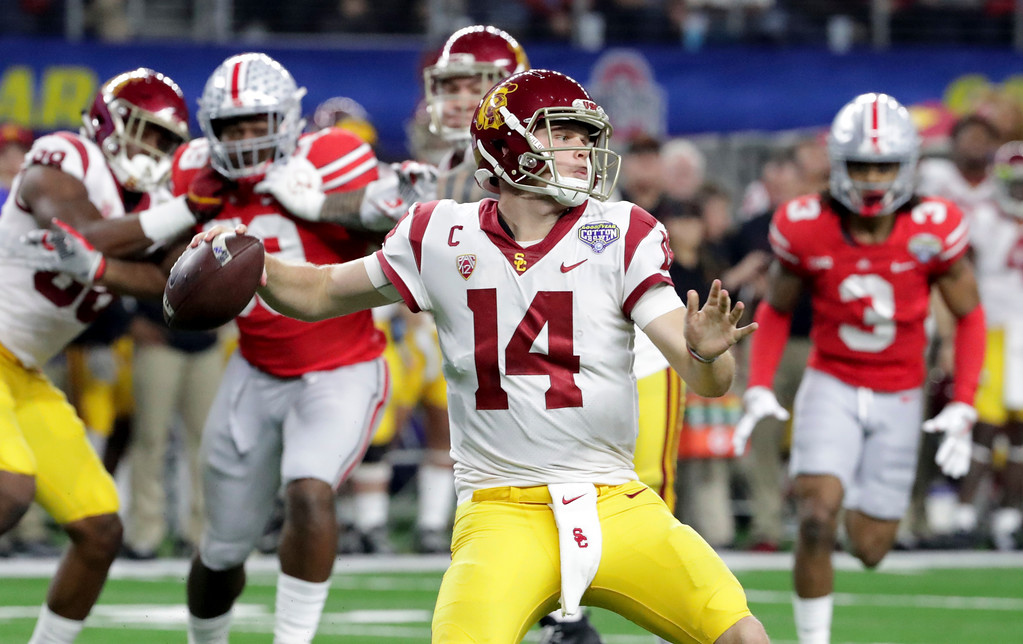 . Southern California quarterback Sam Darnold (14) throws a pass with teammates providing blocking against Ohio State during the first half of the Cotton Bowl NCAA college football game in Arlington, Texas, Friday, Dec. 29, 2017. (AP Photo/LM Otero)