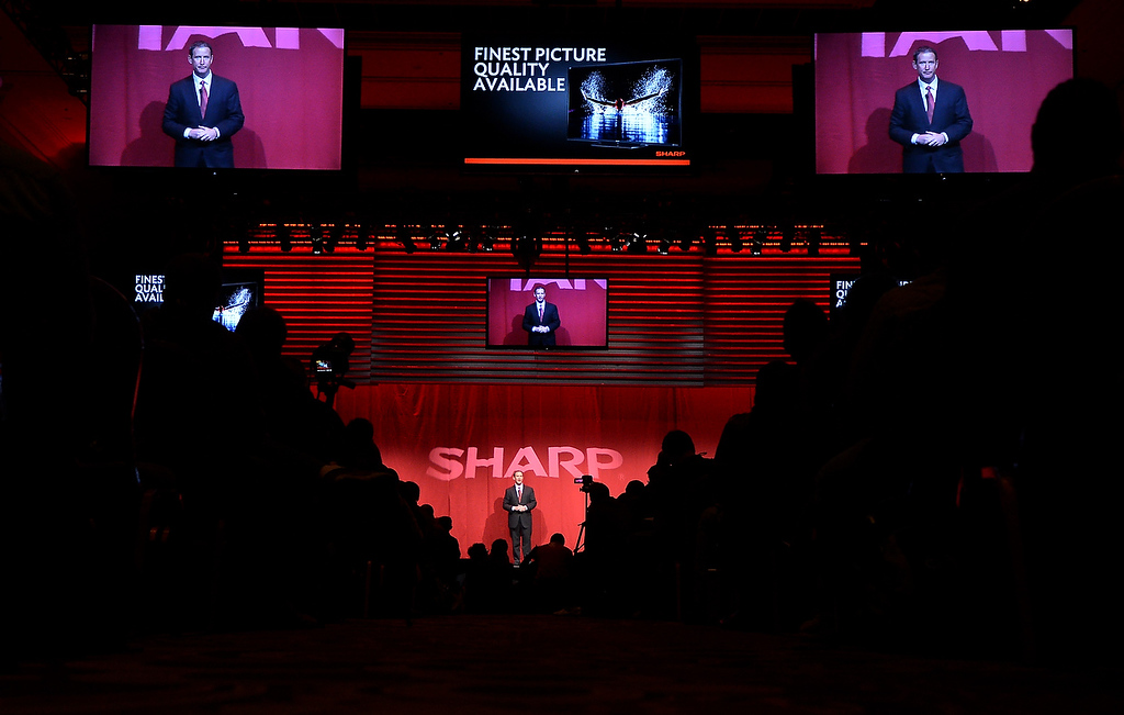 . John Harrington from Sharp Electronics Marketing of America, speaks at the 2013 International Consumer Electronics Show in Las Vegas, Nevada, on January 7 , 2013. (JOE KLAMAR/AFP/Getty Images)