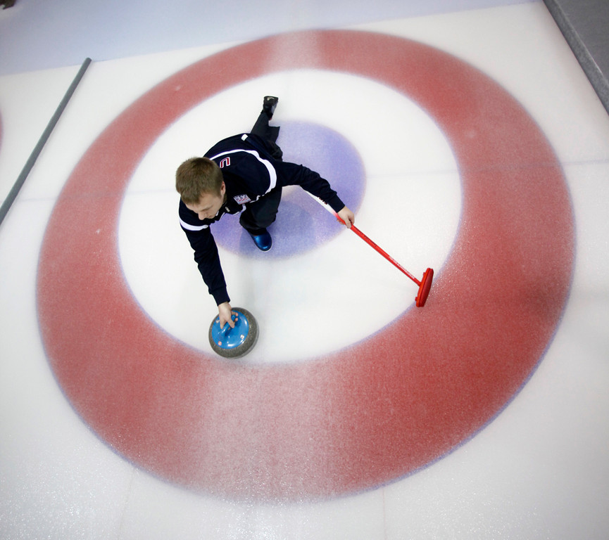 . Jeff Isaacson of Gilbert, Minn., slides through the house as he prepares to throw the rock during practice at the Vancouver 2010 Olympics in Vancouver, British Columbia, Saturday, Feb. 13, 2010. (AP Photo/Robert F. Bukaty)