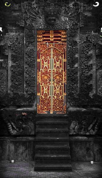The Golden Door, Bali - Indonesia  A traditional Balinese temple door. Intricate stone and metalwork  lend a sense of age, dedication, and craftsmanship.