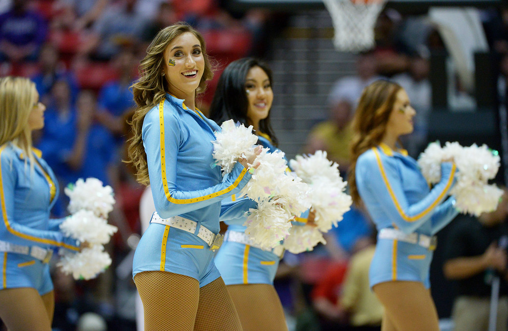 . UCLA Bruins cheerleaders perform in the first half against the Stephen F. Austin Lumberjacks during the third round of the 2014 NCAA Men\'s Basketball Tournament at Viejas Arena on March 23, 2014 in San Diego, California.  (Photo by Donald Miralle/Getty Images)