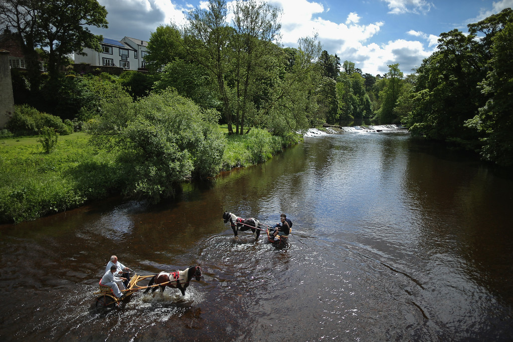 . Travellers wash their horses and traps in the River Eden during the Appleby Horse Fair on June 4, 2015 in Appleby, England. The Appleby Horse Fair has existed under the protection of a charter granted by James II since 1685 and is one of the key gathering points for the Romany, gypsy and traveling community. The fair is attended by about 5,000 travelers who come to buy and sell horses. The animals are washed and groomed before being ridden at high speed along the \'mad mile\' for the viewing of potential buyers.  (Photo by Christopher Furlong/Getty Images)