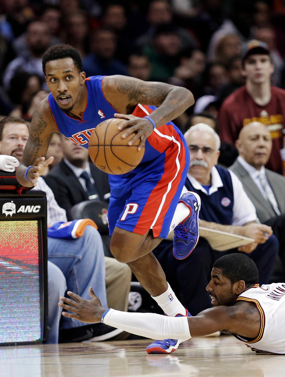 . Detroit Pistons\' Brandon Jennings races upcourt after stealing the ball from Cleveland Cavaliers\' Kyrie Irving, bottom right, during the third quarter of an NBA basketball game Monday, Dec. 23, 2013, in Cleveland. The Pistons won 115-92. (AP Photo/Mark Duncan)