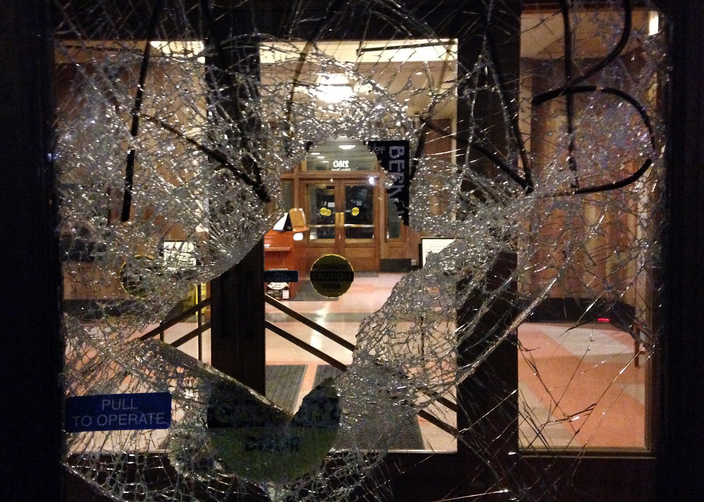 . The front doors of the Martin Luther King Jr. Civic Center building are broken by protesters in Berkeley, Calif., late Sunday evening, Dec. 7, 2014, during a second consecutive night of unrest in the city over the killings of two unarmed black men by police in Ferguson, Mo., and New York. (Karl Mondon/Bay Area News Group)