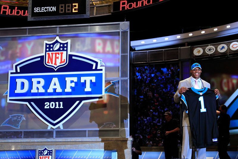 . Cam Newton, Auburn Selected first overall by the Panthers in 2011 After a tumultuous final season at Auburn, Newton burst onto the scene, passing for 4,051 yards and rushing for another 706 on the way to being named the AP Offensive Rookie of the Year. The Panthers fell shy of expectations Newton�s second season, finishing 7-9. GRADE: A. Rookie season may have paved the way for a mobile quarterback revolution in the NFL, and he kept it up his second year. (Photo by Chris Trotman/Getty Images)