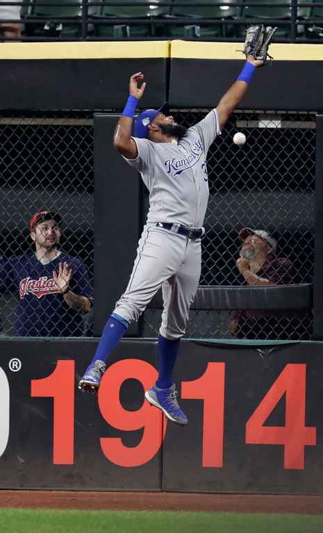 . Kansas City Royals\' Jorge Bonifacio jumps for but can\'t catch a ball hit by Cleveland Indians\' Yandy Diaz during the seventh inning of a baseball game, Tuesday, Sept. 4, 2018, in Cleveland. Diaz had an RBI triple. (AP Photo/Tony Dejak)
