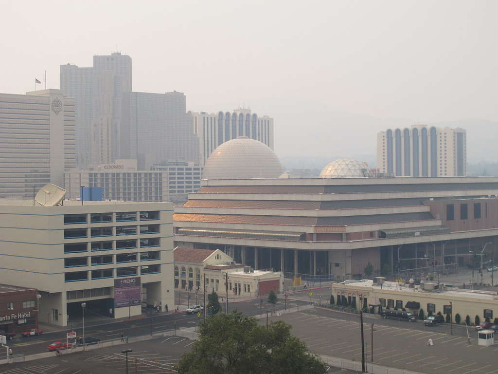 . Hazy smoke from a wildfire more than 150 miles away near Yosemite National Park descended Thursday, Aug. 22, 2013, on Reno and the downtown casino district. Washoe County Health District officials issued an air quality alert because the Air Quality Index worsened to the unhealthy zone for sensitive groups, including the elderly and young children. (AP Photo/Scott Sonner)