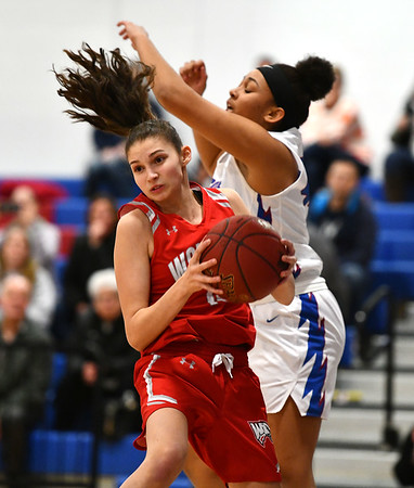 2/7/2020 Mike Orazzi | StaffrSt. Paul's Jade Udoh (42) and Wolcott's Alison LeClerc (15) during Friday night's girls basketball game in Bristol.