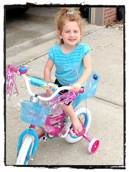 Sloane's new (and first) princess bike.  April, 2012.